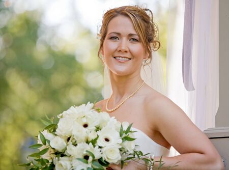 A Stunning Bride Holding Her Beautiful Bouquet photo