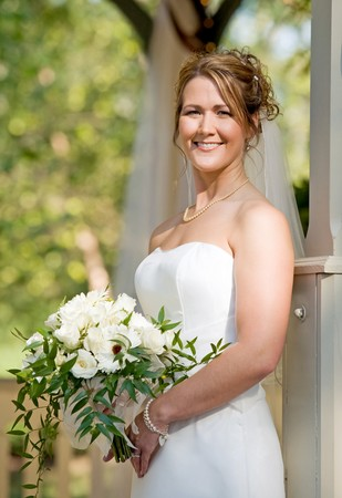 A Stunning Bride Holding a Beautiful Bouquet photo