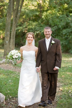 Bride and Groom Walking Together Along a Path photo