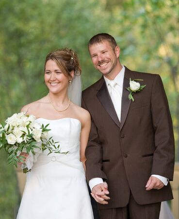 Bride and Groom Holding Hands and Posing