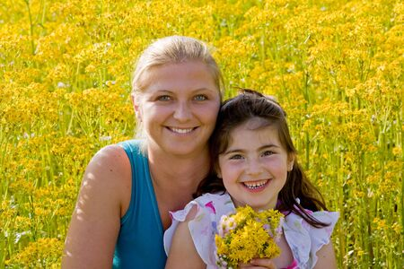Mother and Daughter in a Flower Field photo