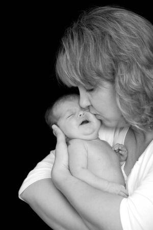 tenderly: Mother Kissing Her Newborn Daughter