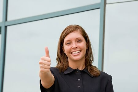 Business Woman Giving a Thumbs Up photo