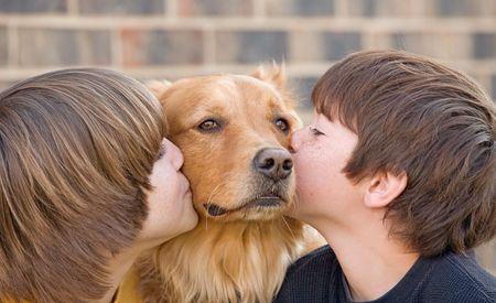Boys Kissing Dog Stock Photo - 4610927