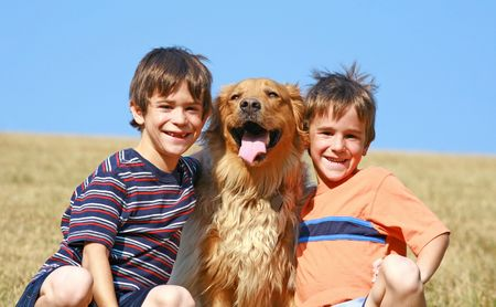 Two Boys with Their Dog Stock Photo - 4661814