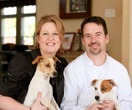 Happy Couple with Their Two Jack Russells