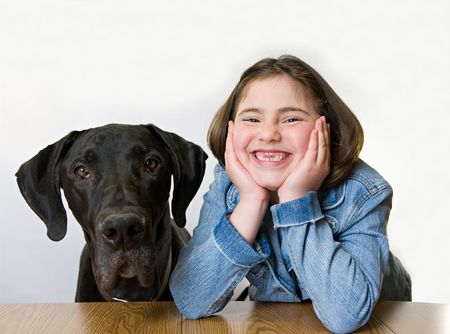 Little Girl With Her Great Dane Stock Photo