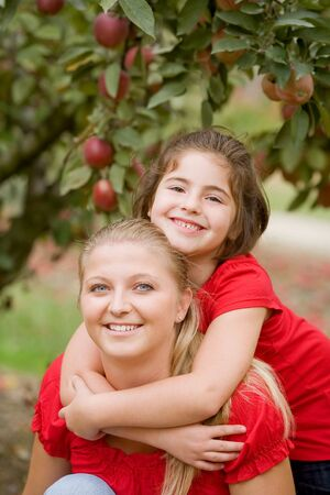 Mother Daughter in the Apple Orchard photo