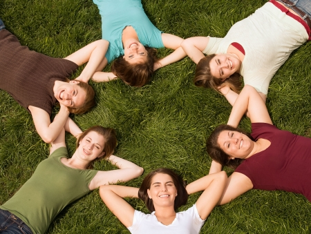 Group of College Girls in a Circle Stock Photo - 4902084