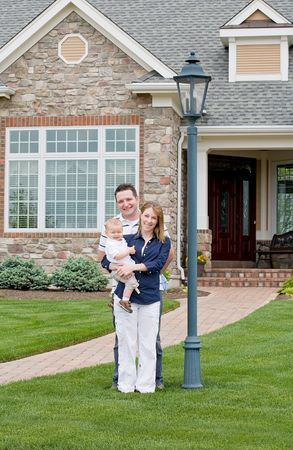 Happy Family in Front of Their Home Stock Photo - 4942061