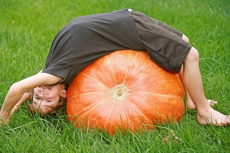 large pumpkin: Boy Playing on a Large Pumpkin Stock Photo