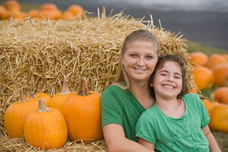 Mother and Daughter in the Pumpkin Patch photo