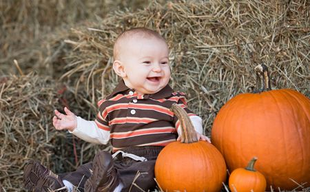 Baby Laughing Sitting at Thanksgiving Time Stock Photo - 5407277