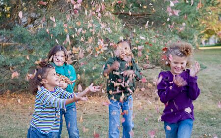 Girls Playing in the Fall Leaves photo