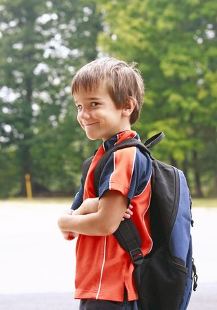 an elementary: Little Boy on First Day of School Stock Photo