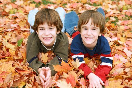 Boys Having Fun in the Leaves photo
