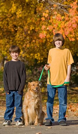 Boys Walking the Dog in the Fall Stock Photo - 5572518