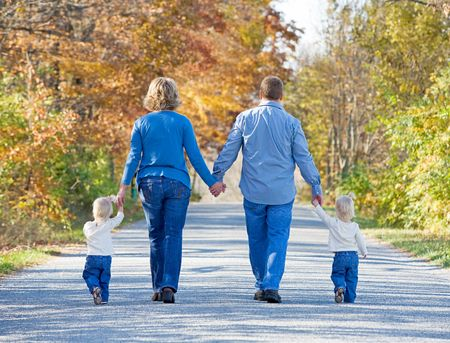 Family Taking a Walk in the Autumn