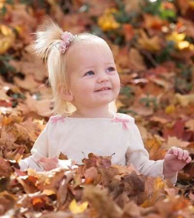 children at play: Girl Playing in Fall Leaves