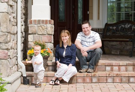 Happy Family of Three Smiling Archivio Fotografico