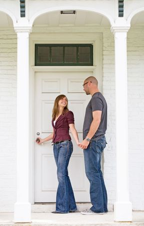 Happy Young Couple Entering Front Door