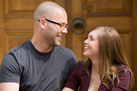 Happy Young Couple Laughing photo