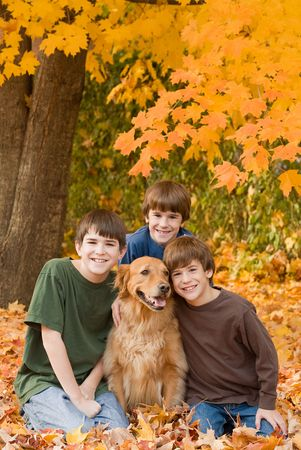 Boys in the Fall Leaves 版權商用圖片 - 5807395