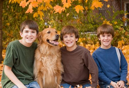 Boys in the Fall Leaves Stock Photo - 5807407