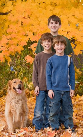 Boys in the Fall Leaves Stock Photo - 5807399