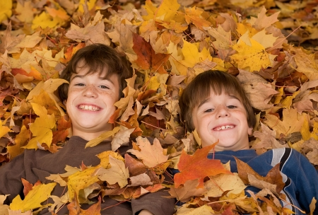 teen boy face: Boys in the Fall Leaves