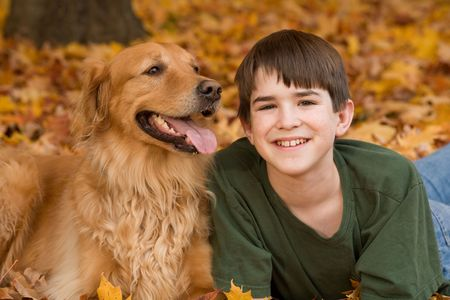 Teenager with Golden Retriever photo