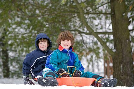 sledding: Boys Having Fun Sledding