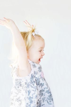 Cute Little Girl Playing With Arms Up photo