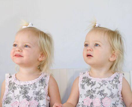 Twins Smiling Having Fun Playing Banco de Imagens - 6347331