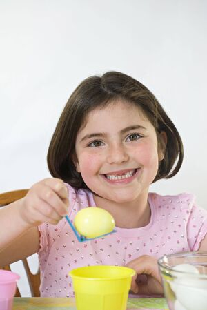 Little Girl Coloring Easter Eggs photo