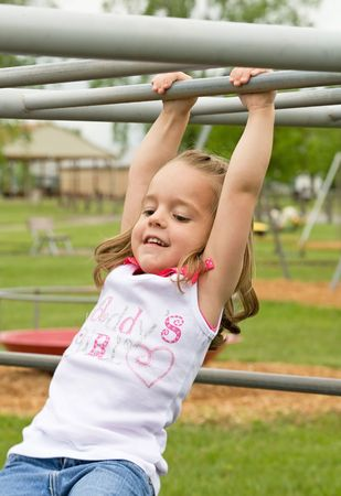Little Girl Playing Outside With Big Smile Banco de Imagens - 6714413
