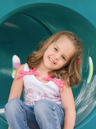 Girl Playing at the Playground