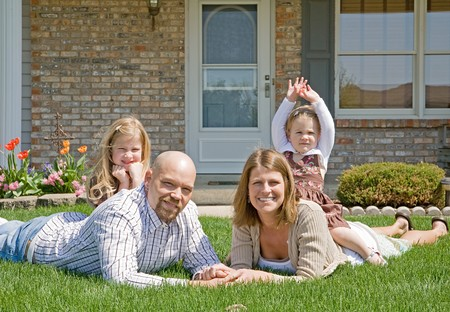 Family in Their Front Yard Stock Photo - 7372369