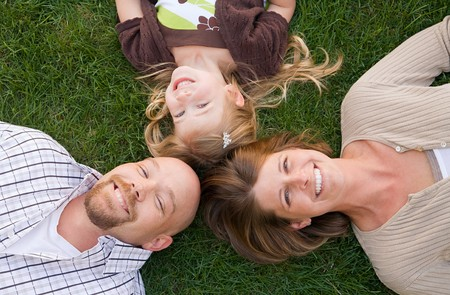 Family Laying Down Smiling
