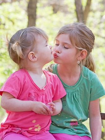 Sisters Showing Affection for Each Other