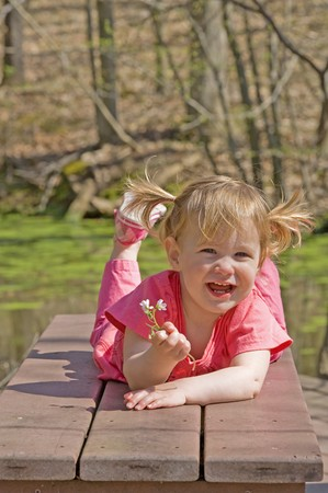 Cute Little Girl Playing at the Park