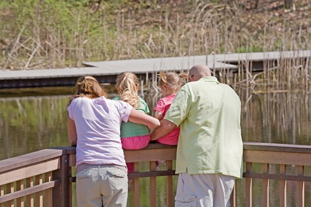 Family Looking at the Water on the Dock Stock Photo - 7484585