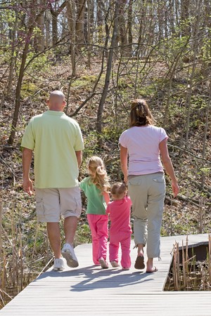 Family Taking a Walk Banco de Imagens