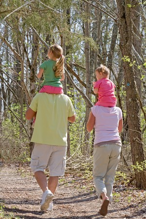 Family Having Fun Taking a Walk in the Woods Banque d'images