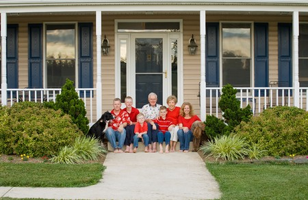 mate married: Happy Family in Front of Their Home