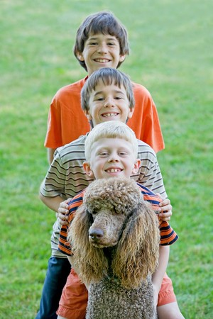 cousin: Three Boys Playing With Their Dog