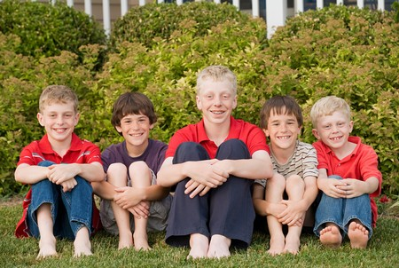 Five Cousins Having Fun Together in a Row Banco de Imagens