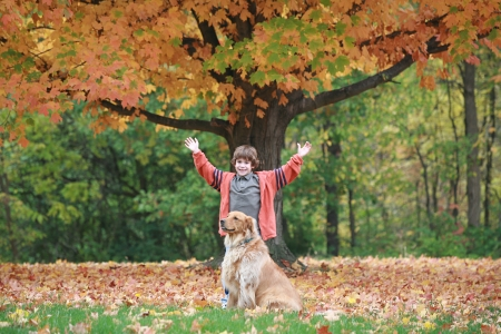 Boy and Dog in the Fall Stock Photo - 23247861