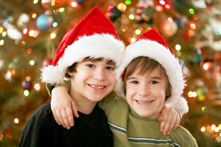 Boy Wearing Christmas Hats photo
