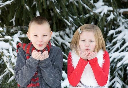 Kids Making Wish Blowing Snow